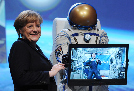 Chancellor Angela Merkel talking to André Kuipers at CeBIT 2012.  Credits: Deutsche Messe AG / ESA